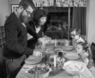 Retro Vintage Family Thanksgiving Day Dinner Turkey. Family celebrates retro vintage Thanksgiving day dinner with turkey and all the trimmings stock image