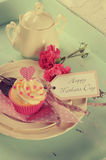 Retro vintage filter Happy Mothers Day shabby chic aqua blue tray. With pink cupcake and greeting tag Stock Image