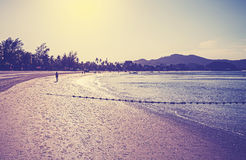 Retro vintage filtered picture of a beach at sunrise Stock Images