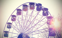 Retro vintage filtered picture of a carousel. Royalty Free Stock Photography