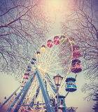 Retro vintage filtered picture of ferris wheel in a park Stock Photo