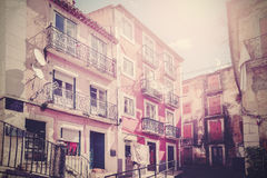 Retro vintage filtered picture of old empty street in Lisbon. Stock Photos