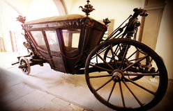 Retro vintage filtered picture of an old wooden carriage. Royalty Free Stock Photo