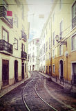 Retro vintage filtered picture of street in Lisbon, Portugal. Royalty Free Stock Photography