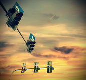 Retro vintage filtered picture of traffic lights at sunset Stock Photography
