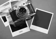 Retro vintage four instant photo frames cards on grey background with images of nature and blank photo with old camera Royalty Free Stock Photo
