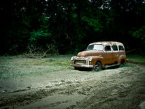 Retro Vintage GMC Station Wagon. An old GMC Station Wagon lays in a muddy field of silt after a flood. White River Junction Vermont royalty free stock photo