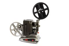 Retro or vintage home movie projector. A retro home movie projector dirty from storage isolated on a white background royalty free stock photo