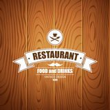 Retro vintage insignia, logotype for restaurant on wood background Royalty Free Stock Photo