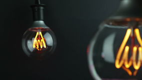 Retro vintage light bulb with led technology built-in with change focus on vintage light bulb in background, energy saving. With old style atmosphere concept stock video footage