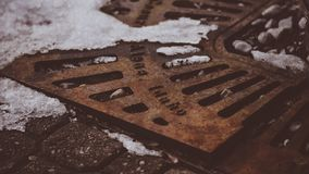 A Retro Vintage Looking Steel Ground Cover On The Street of Coeur d`Alene Idaho. In Winter Stock Image