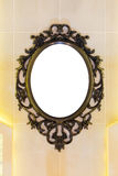 Vintage mirror with metal classic frame on the wall Stock Photos