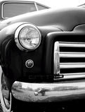 Retro Vintage Old Car. A classic old vintage custom car in black and white.  Black body with shiny chrome accents and gorgeous, sensuous curves Stock Image