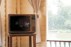 Retro vintage old design TV television in living room. Retro vintage old design wooden TV television in living room Stock Images