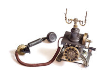Retro vintage phone isolated. Decorated retro vintage metal telephone isolated on white background Royalty Free Stock Photos