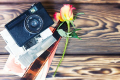 Retro vintage photo camera pictures on wooden background. Stock Photo