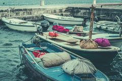 Retro vintage picture of boats in port. In Petrovac, Montenegro royalty free stock images