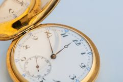 Retro vintage pocket gold watch with an open lid royalty free stock photos