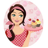A retro vintage portrait of a woman holding cupcakes a baker woman. Wearing a pink dress and has a cupcake and pink background Stock Image