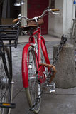 Retro vintage red bike. On cobblestone street in the Paris. Old charming bicycle concept Stock Photo