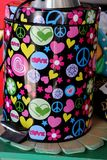 Retro Vintage 1960`s 1970`s Canister. Colorful Peace Sign Groovy Hearts Stock Image