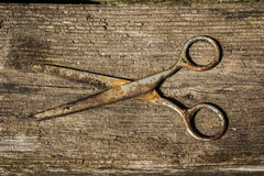 Retro vintage scissors on the wooden background Royalty Free Stock Image