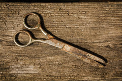 Retro vintage scissors on the wooden background Royalty Free Stock Photo