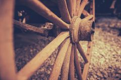 Disused old cart wheel closeup. Retro vintage sepia image of a disused old wooden cart wheel Stock Images