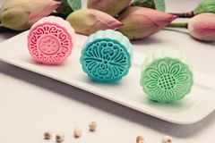 Retro vintage style Chinese mid autumn festival foods. Tradition. Al mooncakes on table setting stock photography