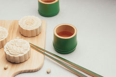 Retro vintage style Chinese mid autumn festival foods. Tradition. Al mooncakes on table setting royalty free stock photography