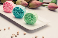 Retro vintage style Chinese mid autumn festival foods. Tradition. Al mooncakes on table setting royalty free stock images