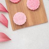 Retro vintage style Chinese mid autumn festival foods. Traditional mooncakes on table setting.  royalty free stock image