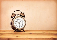 Retro and vintage style of Old fashioned the alarm clock on wood Royalty Free Stock Photos