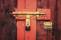 Retro vintage style picture of wooden door with lock. Stock Photos