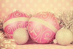 Retro vintage style pink Merry Christmas baubles Royalty Free Stock Photography