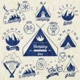 Retro vintage style symbols for Mountain Expeditio. Mountain Camping, Mountain Hunting, Mountain Tour, Mountain Foods, Camping site, Camping Grill, Biking Tours Stock Photography