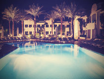 Retro vintage stylepicture of pool at night. Royalty Free Stock Photo