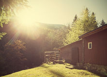 Retro vintage stylized mountain shelter with flare effect. Stock Photos