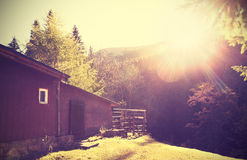 Retro vintage stylized mountain shelter with flare effect. Stock Image