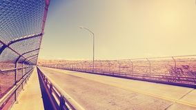 Retro vintage stylized picture of a highway against sun. Stock Images