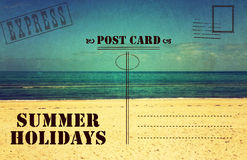 Retro vintage Summer Holidays Vacation postcard. Retro vintage filter style old faded Summer Holidays Vacation postcard with ocean beach scene and text Stock Image