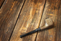 Retro vintage tobacco pipe on wooden table Stock Photo