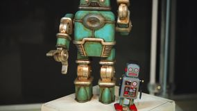 Retro vintage toys robots standing near each other. Naive design of toys
