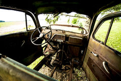 Retro vintage truck interior. Old vintage retro vintage truck out back on farm land rotting away all rusty interior view Stock Photography
