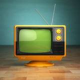 Retro vintage tv on green background. Television concept. Royalty Free Stock Image