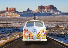 VW Van Bus, Travel, Vacation, American Southwest. A retro vintage VW Hippie VW bus van is on an American highway in the southwest United States. People like to Stock Images