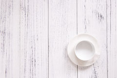 Retro vintage white painted wood floor ceramic coffee cup backgr Stock Image