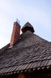 Retro vintage wooden roof new red brick chimney Stock Image