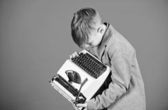 Retro and vintage. Yard sale. Retrospective study. Boy hold retro typewriter on blue background. What to do with this. Thing. Out of date. I need modern gadget stock photography