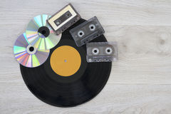 Retro, vinyl record disc, audio cassette and cd Stock Photography